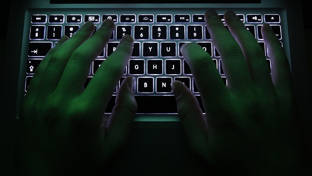 A man types on a computer keyboard in Warsaw in this February 28, 2013 illustration file picture.  High-level Chinese hackers recently tried to break into a key Canadian computer system, forcing Ottawa to isolate it from the main government network, a senior official said on July 29, 2014. REUTERS/Kacper Pempel/Files (POLAND - Tags: BUSINESS SCIENCE TECHNOLOGY)