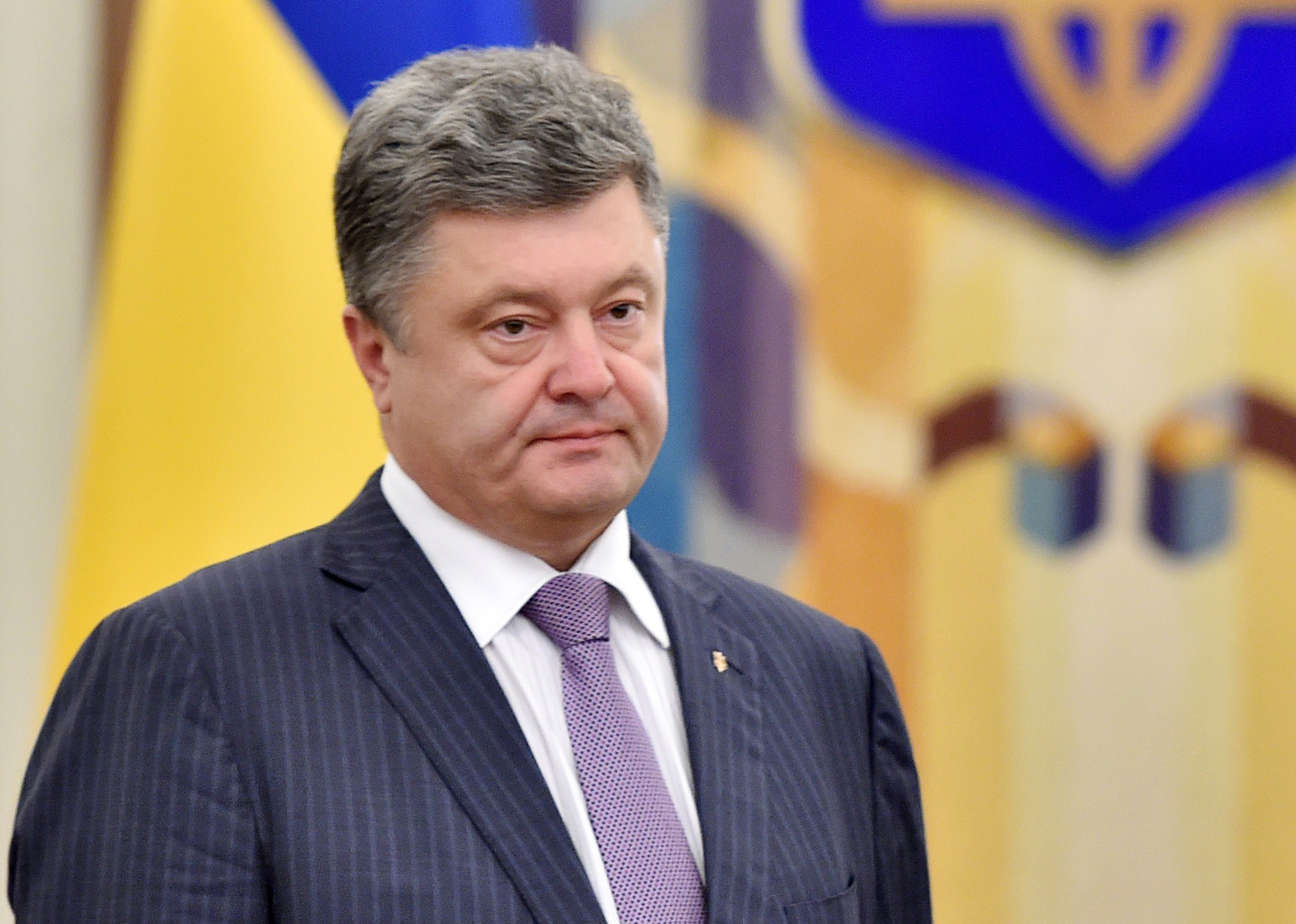 Ukrainian President Petro Poroshenko arrives for a National Security and Defence Council sitting in Kiev on June 16, 2014. Poroshenko said during the opening of the sitting that a ceasefire was the beginning of his peace plan for resolving the conflict in eastern Ukraine.  AFP PHOTO/ SERGEI SUPINSKY        (Photo credit should read SERGEI SUPINSKY/AFP/Getty Images)