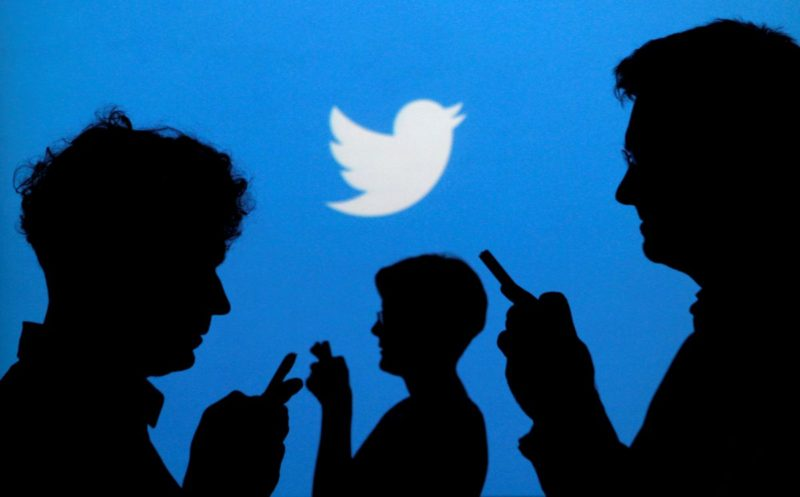 "People holding mobile phones are silhouetted against a backdrop projected with the Twitter logo in this illustration picture taken in  Warsaw September 27, 2013.   REUTERS/Kacper Pempel/Illustration/File Photo     GLOBAL BUSINESS WEEK AHEAD PACKAGE - SEARCH ""BUSINESS WEEK AHEAD JULY 25"" FOR ALL IMAGES"