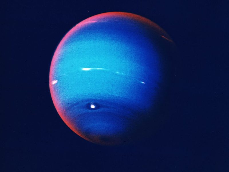 circa 1970:  Neptune, fourth largest of the planets in our solar system. The atmosphere consists mostly of hydrogen and helium, but the presence of three per cent methane lends the planet its striking blue hue. <script async src=