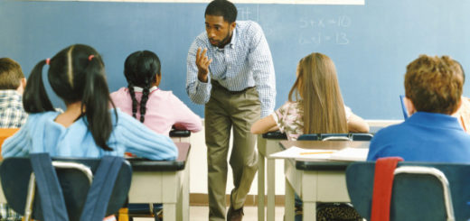 Teacher Answering a Girl in a Primary School Class