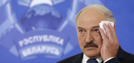 Belarus' President Alexander Lukashenko wipes his face at a news conference during a presidential election in Minsk, Belarus, October 11, 2015. Belarussians head to the polls on Sunday to cast their vote in presidential elections all but certain to re-elect authoritarian incumbent Alexander Lukashenko for a fifth term. REUTERS/Vasily Fedosenko